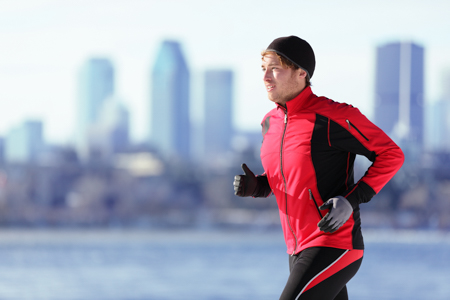 A man running in front of city