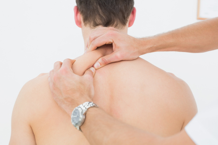 Doctor squeezing patient muscle