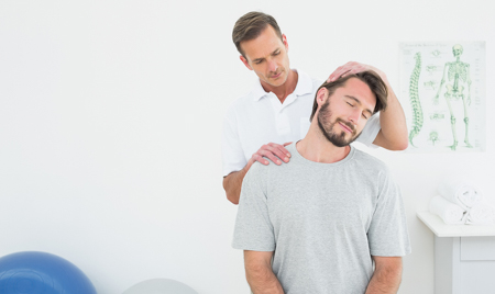 Doctor Cracking Neck Of Patient